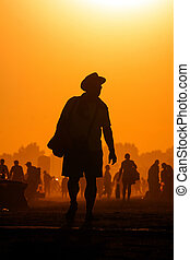 People traveling in the sunset at noon