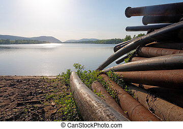 Large pipes running into the lake