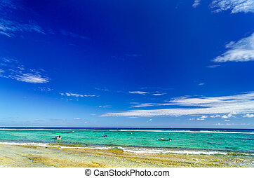 Turquoise Sea and Blue Sky - View of boats on the Caribbean...