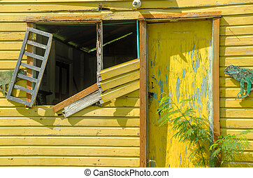 Dilapidated Yellow Building - Old abandoned yellow building...