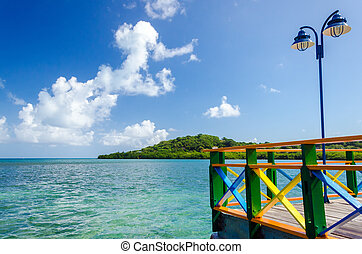 Colorful Bridge and Sea View - View of Caribbean Sea on a...