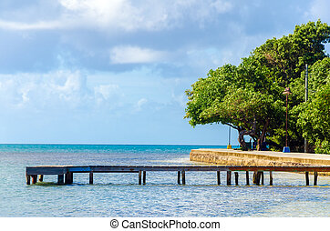 Old Wooden Pier - Old wooden pier in the Caribbean Sea on...