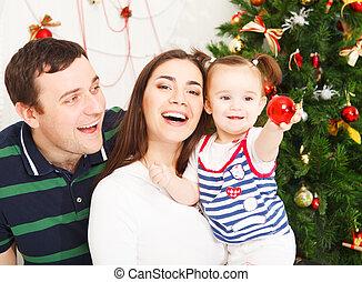 Happy family near the Christmas tree