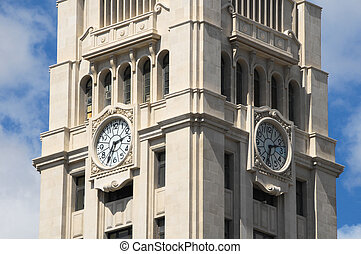 Clock on a Brown Tower - Watch Clock on a Brown Tower on a...