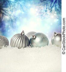 Christmas baubles on the snow - Silver Christmas baubles on...