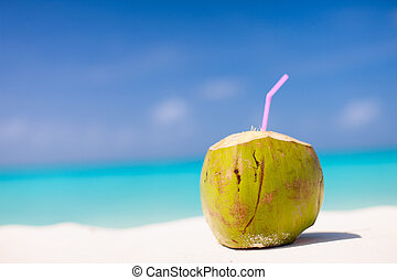 Coconut on a tropical beach - Tropical cocktail in a coconut...