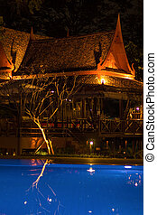 Thai resort with pool at night view