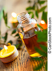 essential oil,candles and flowers - bottles of essential...