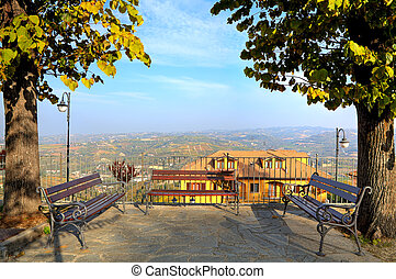 Benches over hills in Piedmont, Italy. - Three benches on...