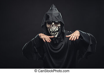 skeleton in a black robe with glasses dancing - jolly...