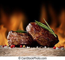 Beef steaks - Delicious beef steaks on wood