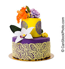 Colorful cake decorated with candy flowers and lace -...