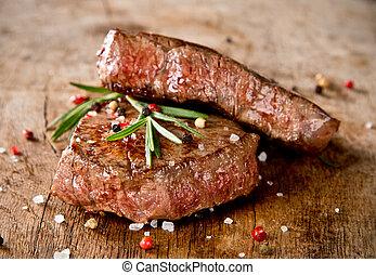 Beef steaks - Delicious beef steaks on wood