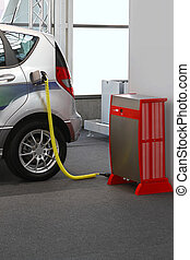 Electric car charging - Electric vehicle with plugged cable...