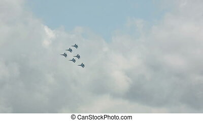 Aerobatics - Sukhoi Su-27 jet fighters performing group...