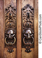 Door Knobs - Two door knobs with knocking rings and animal...
