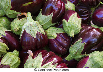 Eggplants - A pile of selected fresh eggplants for sale in a...