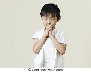 little asian boy - six year old little asian boy praying