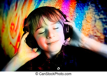 color music - Little boy with headphone over colored...