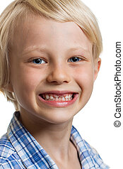 Cute boy with missing front teeth