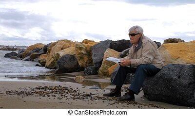 Senior man reading newspaper relax - Elder man reading...