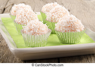 strawberry champagne truffle with coconut flakes in mini cup...