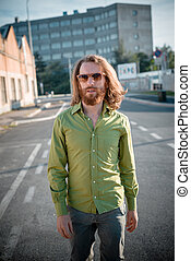 stylish hipster model with long red hair and beard lifestyle...
