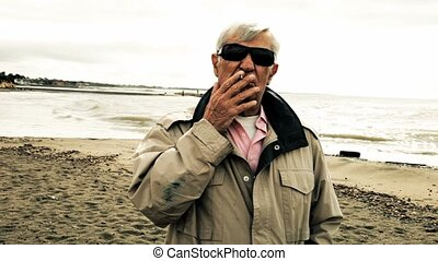 Old sick man smoking - Mafia old boss smoking cigarette on...