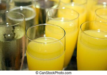cheers - glasses of champagne and orange juice
