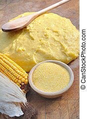 corn flour for polenta - bowl of corn flour on wooden board...