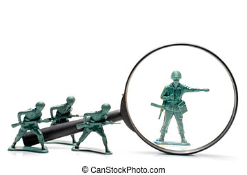 Army Men - A toy soldier being investigated under a...
