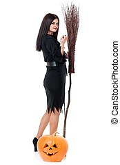 Young witch - Young beautiful witch with broom and pumpkin...