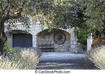 entrance arches and stone cottage
