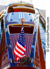 Wooden craft proudly displays flag - Wooden craft proudly...