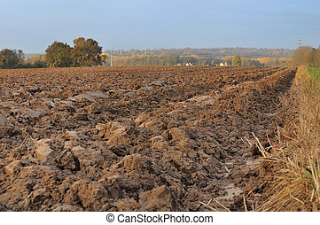 agricultural land - field of freshly turned topsoil forming...