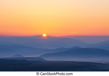 The sun rises over the mountains. natural landscape
