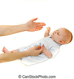 baby and parent\'s hands over white