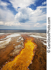 Colorful runoff from Black Pool leads to Yellowstone Lake,...