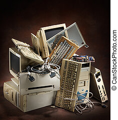 old computers - stack of old and obsolete computer equipment