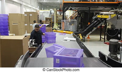 Assembly Line Workers - An assembly line conveyor belt...