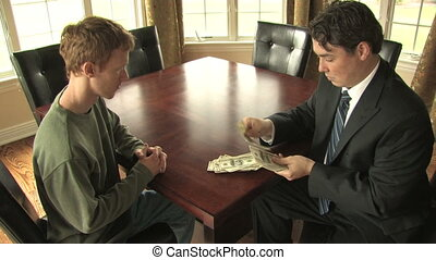 Business Transaction - A businessman in a suit counts a...