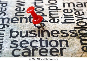 Push pin on business text
