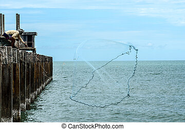 People fishing with nets at sea