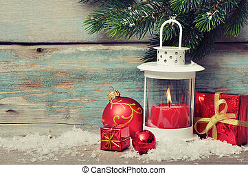 Christmas decoration with candle in lantern and fir tree...
