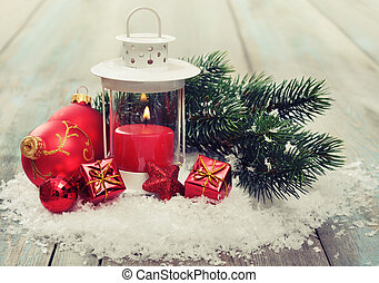 Christmas decoration with candle in lantern and fir tree on...