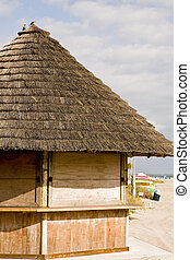 Beachside Straw Hut Closed - A bamboo and straw hut on an...