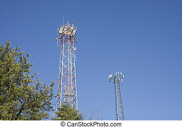 Cell Phone Towers in Pine Trees - High power towers rising...