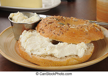 Bagel with cream cheese - A bagel with cream cheese and...