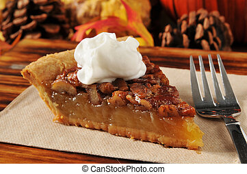 Pecan pie with whipped cream - A slice of pecan pie on a...