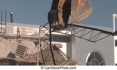 Crane Moving Rubble 1 - A crane moves rubble around at a...